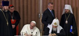 Pope Francis (L) and the head of the Russian Orthodox Church, Patriarch Kirill (C), sign documents after a historic meeting next to Cuban President Raul Castro (4-R) in Havana on February 12, 2016. Pope Francis and Russian Orthodox Patriarch Kirill kissed each other and sat down together Friday at Havana airport for the first meeting between their two branches of the church in nearly a thousand years. AFP PHOTO / POOL - Alejandro Ernesto / AFP / POOL / ALEJANDRO ERNESTO        (Photo credit should read ALEJANDRO ERNESTO/AFP/Getty Images)